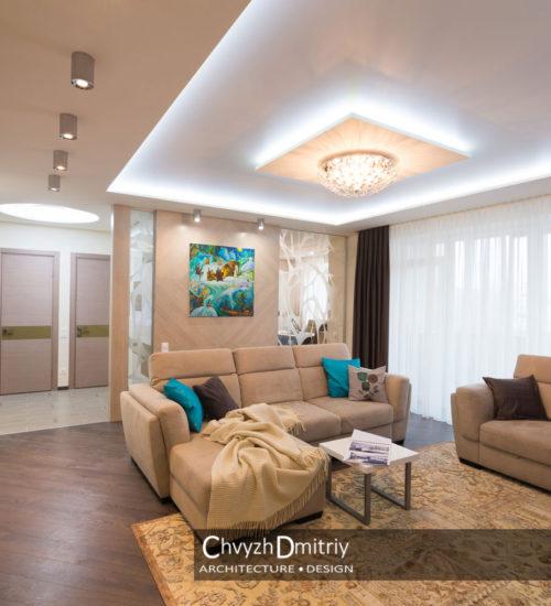 Гостиная холл диван кресло столик прихожая коридор консоль твзона стеклянная перегородка шпонированные панели картина текстиль декор люстра подсветка свет современный дизайн интерьер квартиры минимализм фьюжн дизайн гостиной