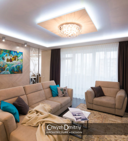 Гостиная холл диван кресло столик консоль твзона стеклянная перегородка шпонированные панели картина текстиль декор люстра подсветка свет современный дизайн интерьер квартиры минимализм фьюжн дизайн гостиной